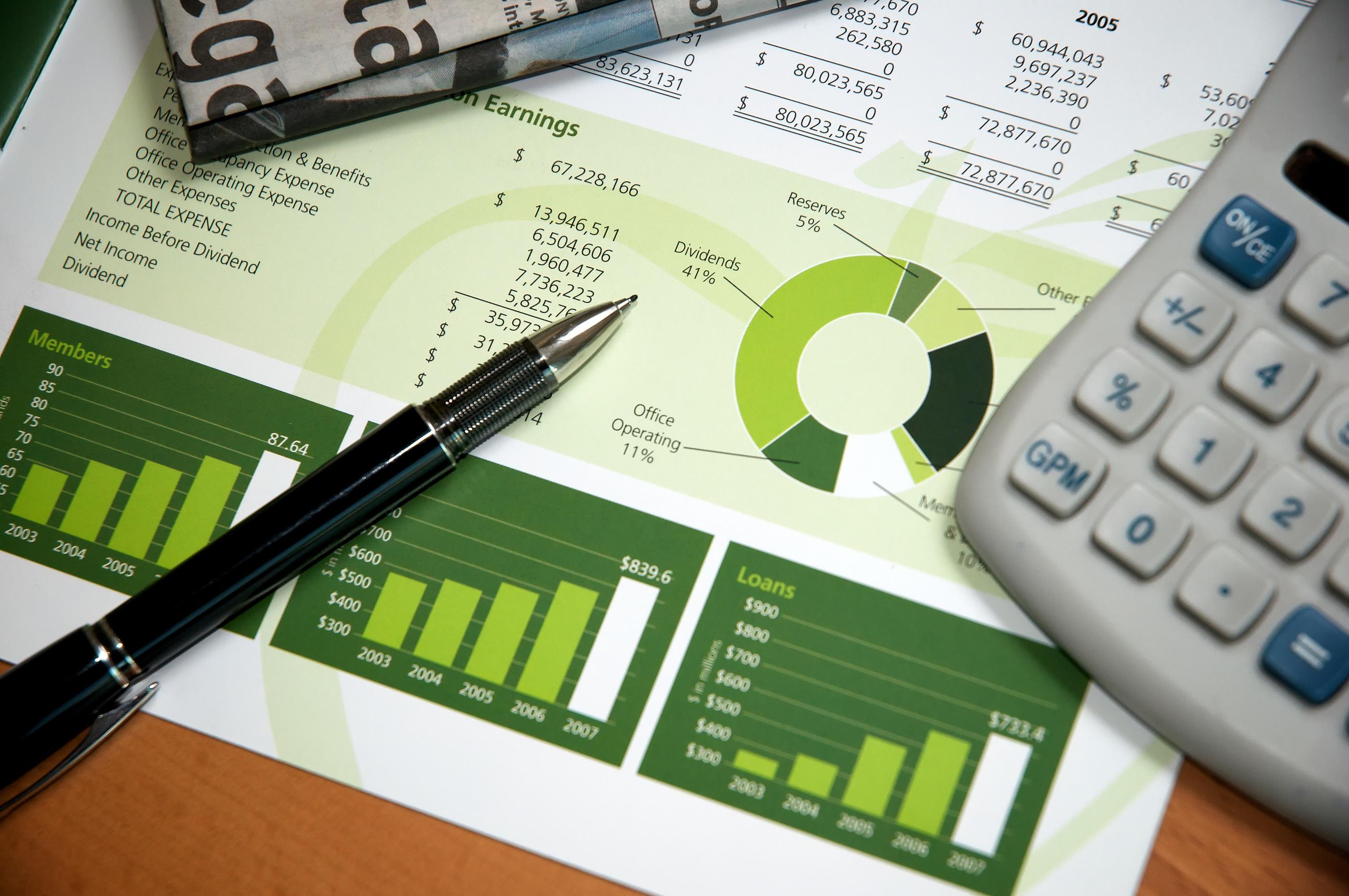 bigstock-Financial-Review-Desktop-5586814.jpg